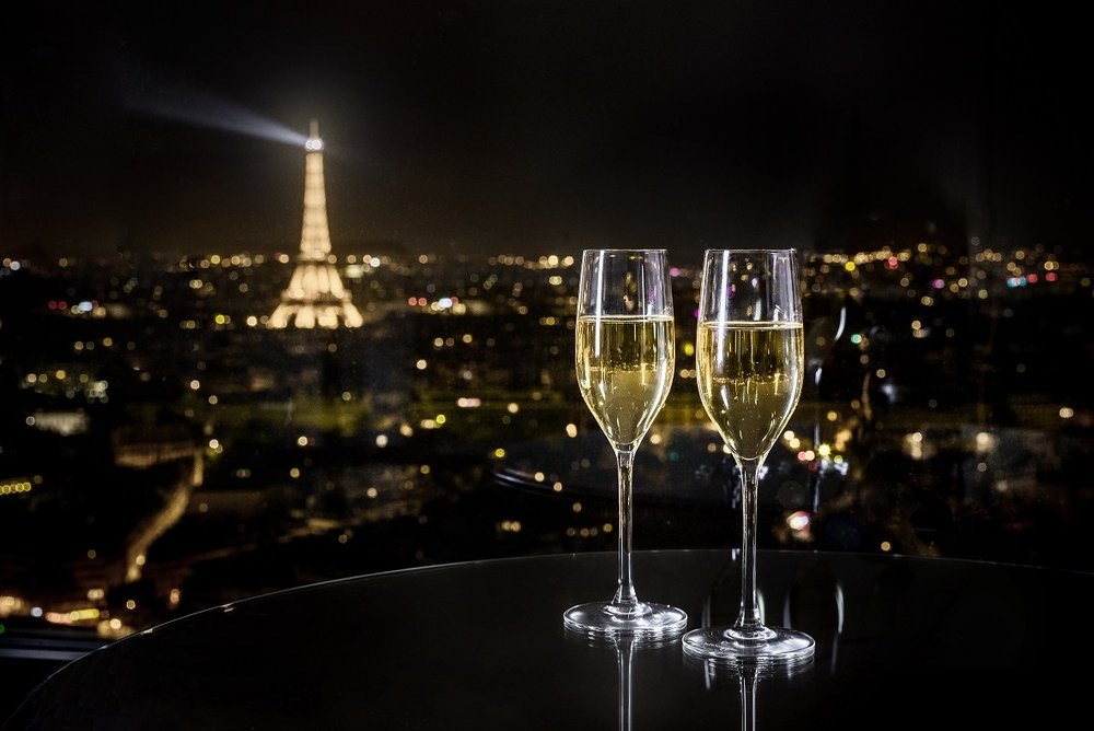 champagne glass and eiffel tower view from bar windo