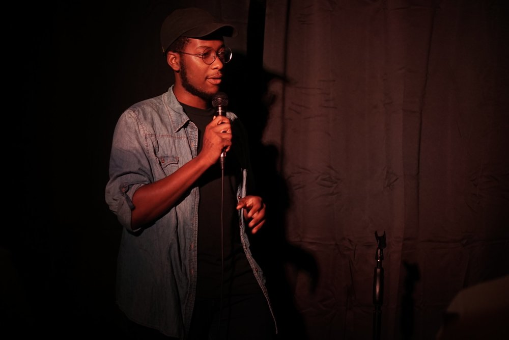 """Tadiwa Mahlunge   """"Tadiwa Mahlunge has been performing for 3 years. An expat from the far away land of Wales, he sheds a new light on topics such as race, sexuality and the streets."""""""