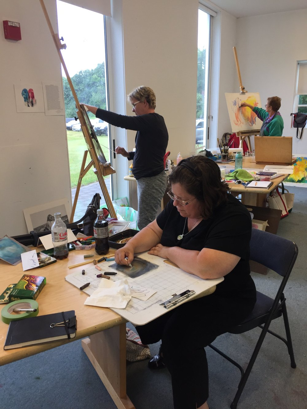 students work away on their individual paintings