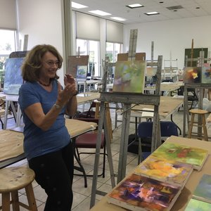 a painting student shows excitement at her new work