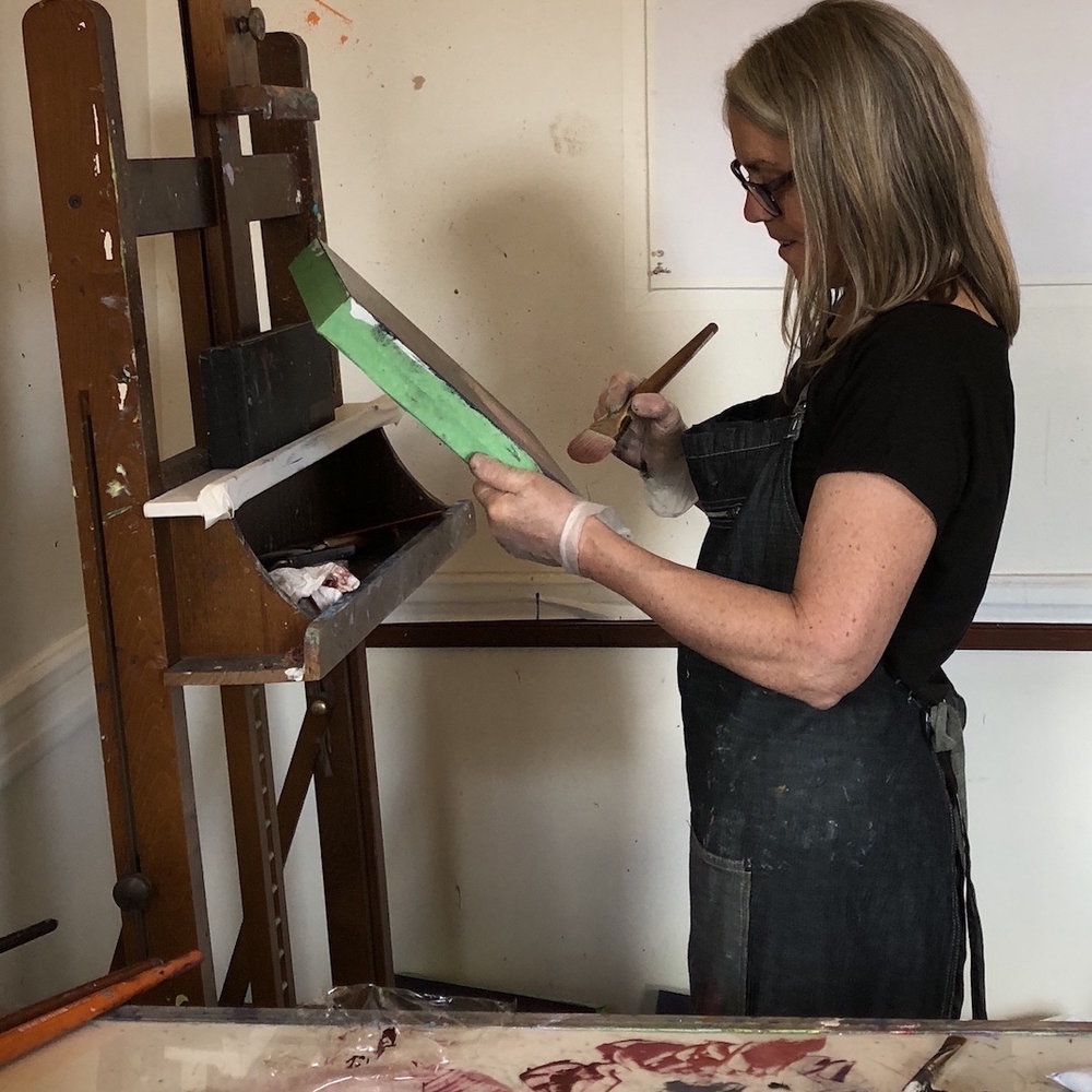 Woman painting a piece