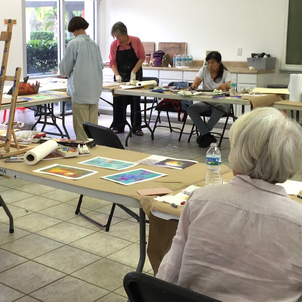 students create oil paintings while at a destination painting workshop