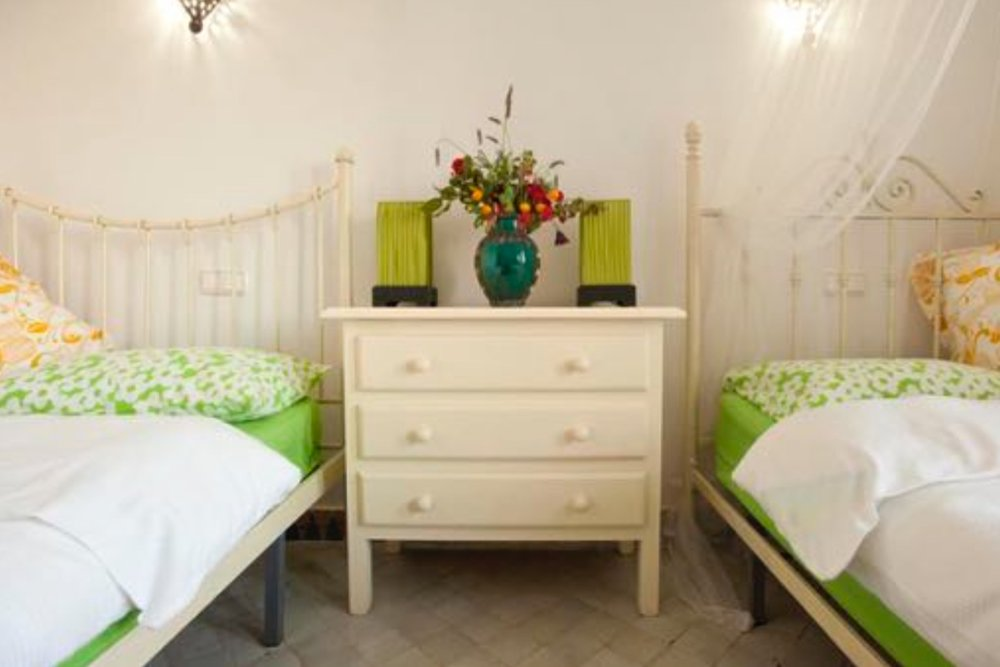 Twin Beds  Shared bath/shower  Garden views   Early Bird: £1,500.00 / Full Price: £1,800.00 *    * Price based on two sharing