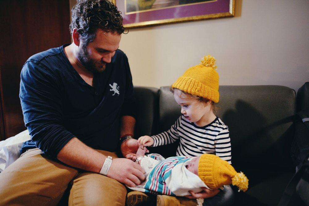 My brother-in-law, Charlie (Kenna's Dad) helping Kenna meet her new sister. Adorable yellow hats made by Caroline (my sister, Kenna's Mom, not pictured upon request)