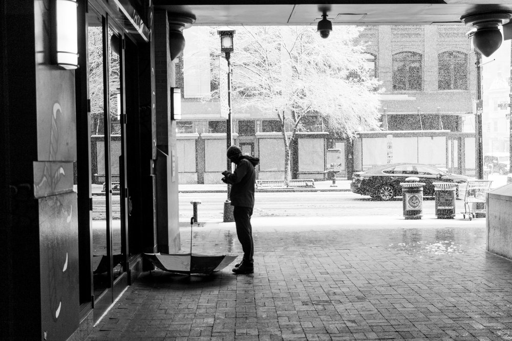 Whit Man Standing in the Snow in Chinatown