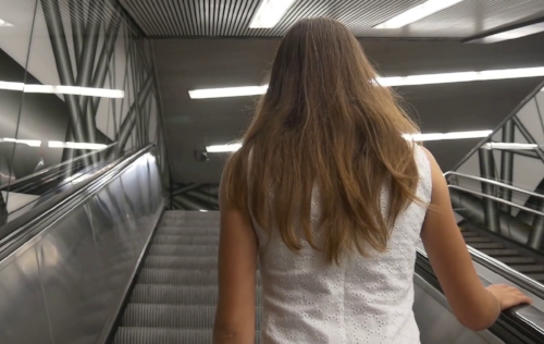 woman on an escalator.jpg