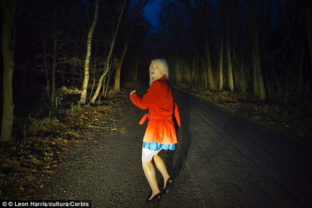 woman running being chased in the dark.jpg