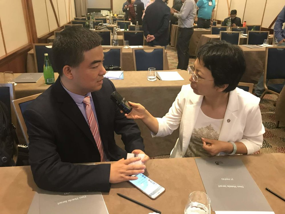 Being interviewed by Hainan Television