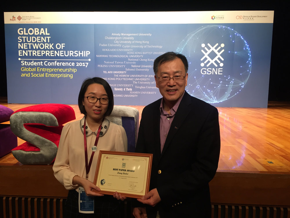 Presenting an award to a Peking University student attending the Global Student Network for Entrepreneurship competition