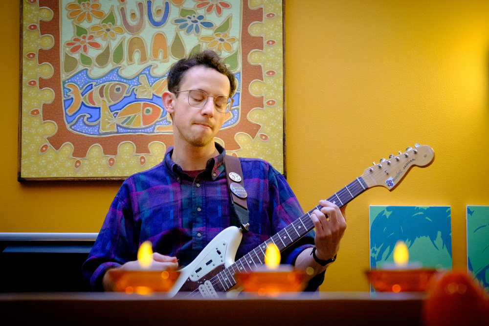 Low interior lighting makes for challenging exposures. Here, Keith Bower Brown of the band Trails and Ways performs at a private house party.  Camera: Fujifilm X-T1 Shutter speed: 1/125 second Aperture: f/5.0 ISO: 3200 Photo: Jeff Carlson