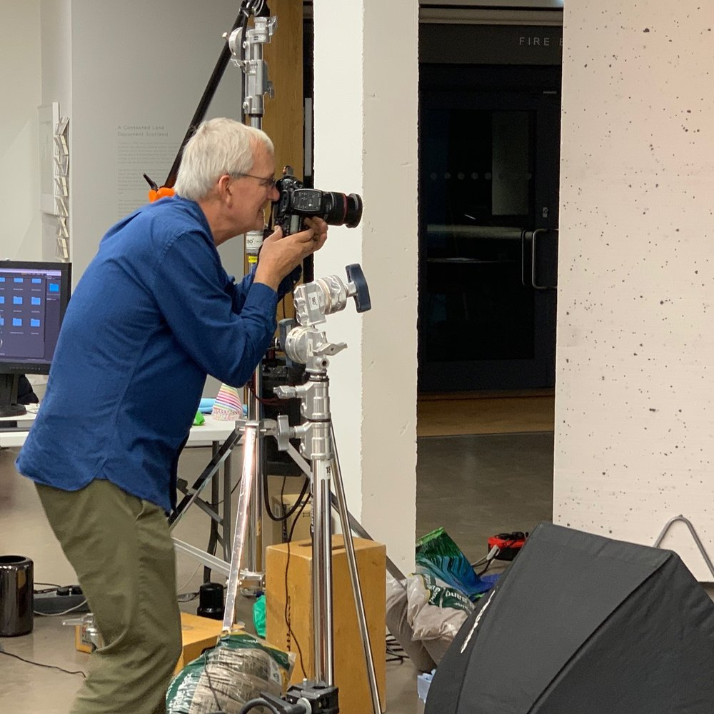 Martin Parr directs a portrait session  Camera: iPhone XS Max Shutter speed: 1/50 sec Aperture: f/2.4 ISO: 80 Photo: Kirk McElhearn