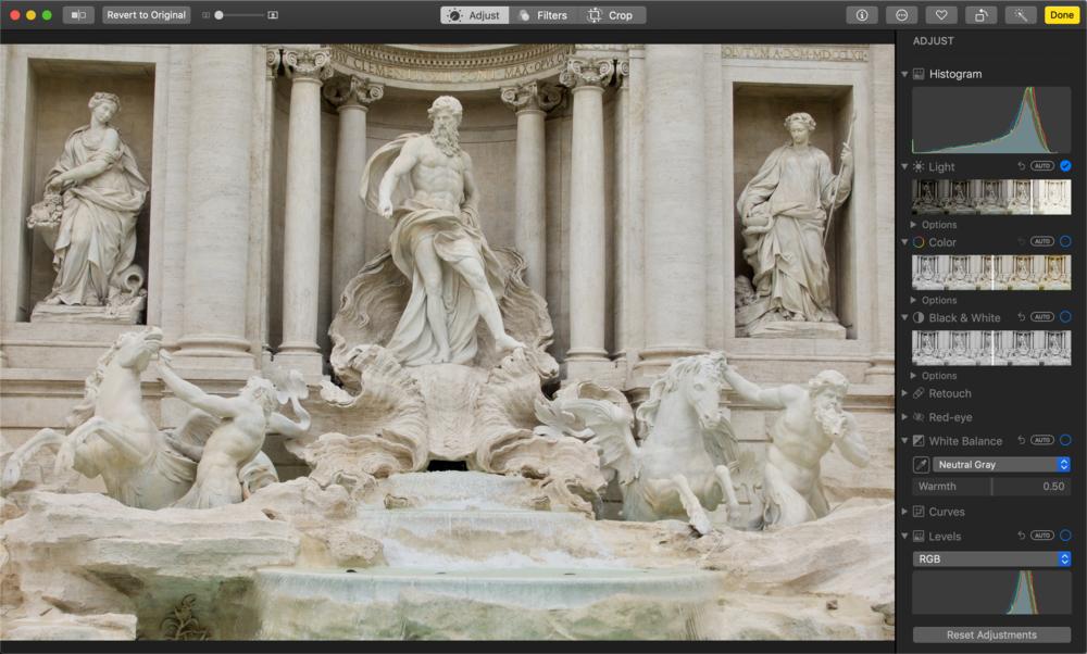 06:45 Using the Light slider in Photos.