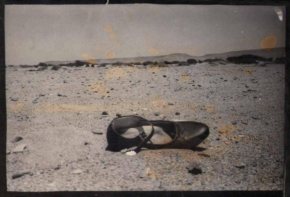 Update from Shoe From Peru FB page: On August 7, 2016, we learned that Claudia Luthi, kind soul and compassionate photographer, had passed away. She was much loved and is sorely missed!  Claudia found the Shoe From Peru, a little girl's patent leather shoe, on a riverbed after a big flood in 1998. Starting in May 2008, the shoe travelled the world for six years before it finally returned to Claudia's home in Lima, Peru, in August 2014.  This is one of the photos Claudia took of the shoe as she found it on that riverbed in the Rio Ica Valley nearly two decades ago.