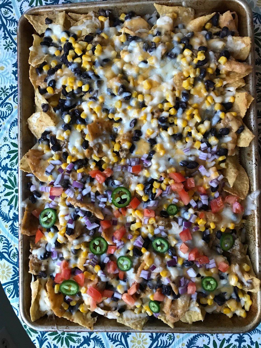 Tips on how to turn nachos into a family dinner that the kids will love (duh) and can actually deliver some health too | Didn't I Just Feed You , a podcast about feeding families