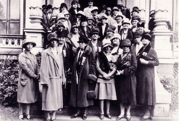 In 1928, club members and their guests posed on the front steps of the Amherst Woman's Club, celebrating the 35th year as a club. On the front row stands Amy Barnes Maynard, founder of the club (third from left facing photo).