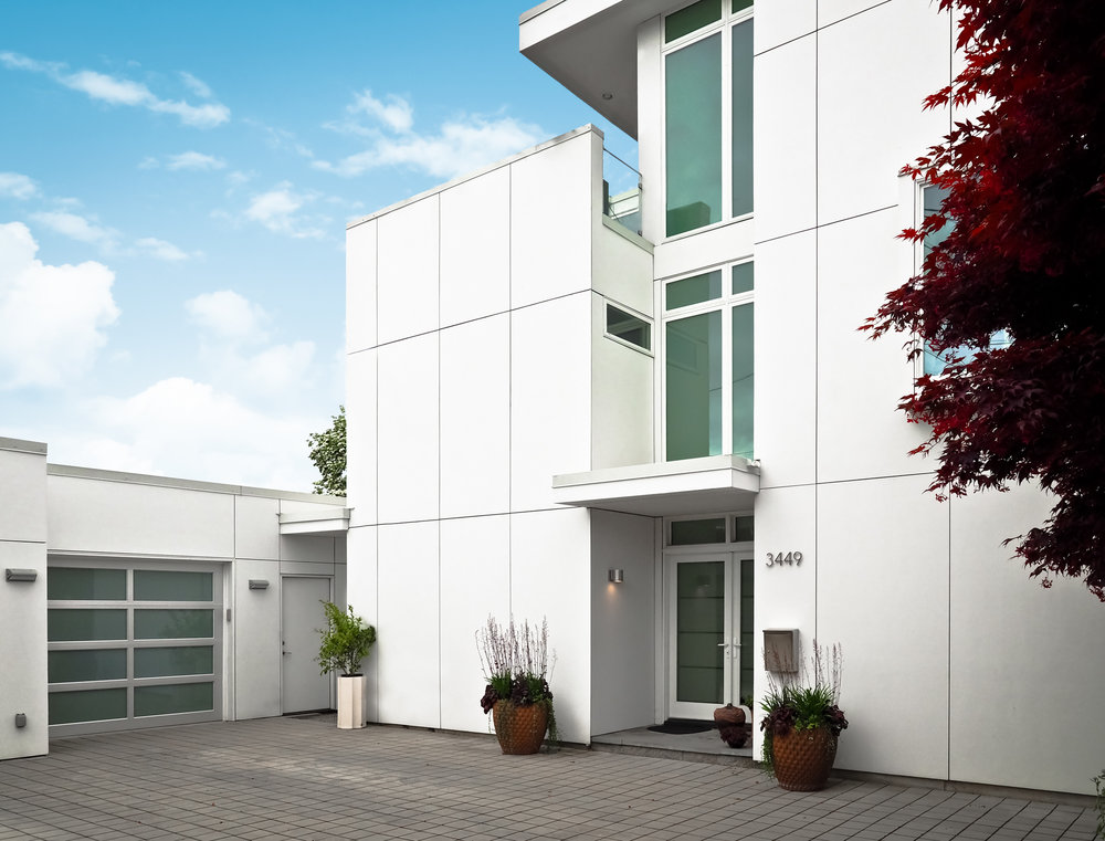 real estate architectural photography image of modern all white home exterior