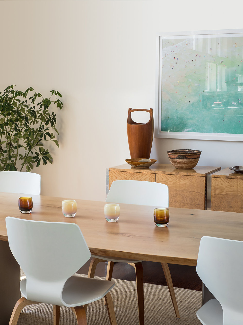 dining room table with modern chairs and artwork