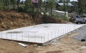 shipping-container-construction-concrete-slab-foundation-300x186.jpg