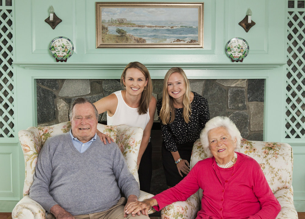 Granddaughter Ellie LeBlond Sosa (left) and coauthor Kelly Anne Chase (right) with President George H.W. and Barbara Bush in their home in Kennebunkport, Maine.  Photograph by Heidi Kirn