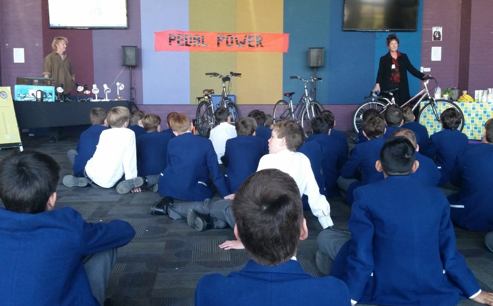 High School Students - Using the bicycle generators, students cycle to see how many incandescent and energy-saving light globes they can power