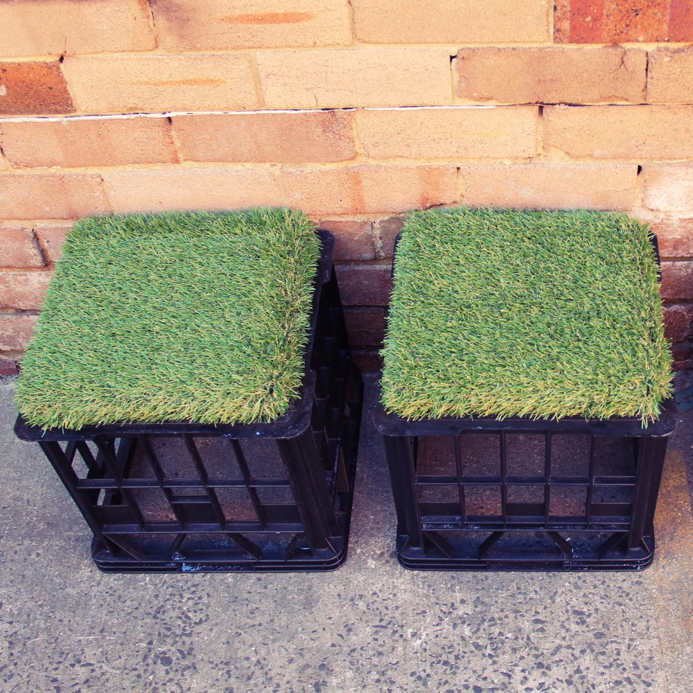 Milk crate seats with astro-turf cushion