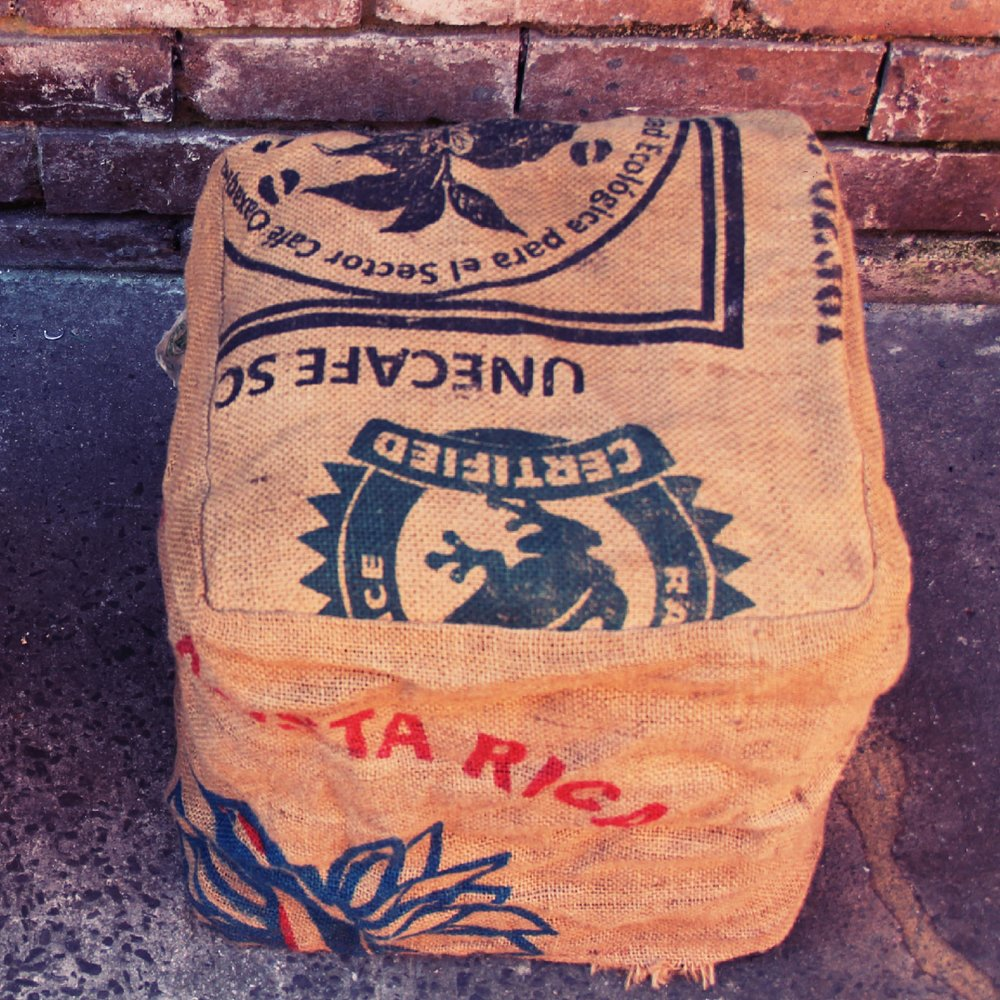 Milk crate seat with coffee sack cover
