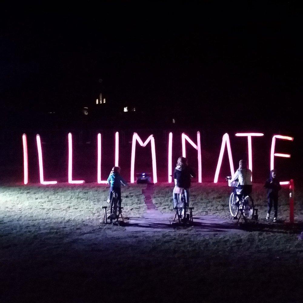 Illuminate milk bottle installation - bike powered