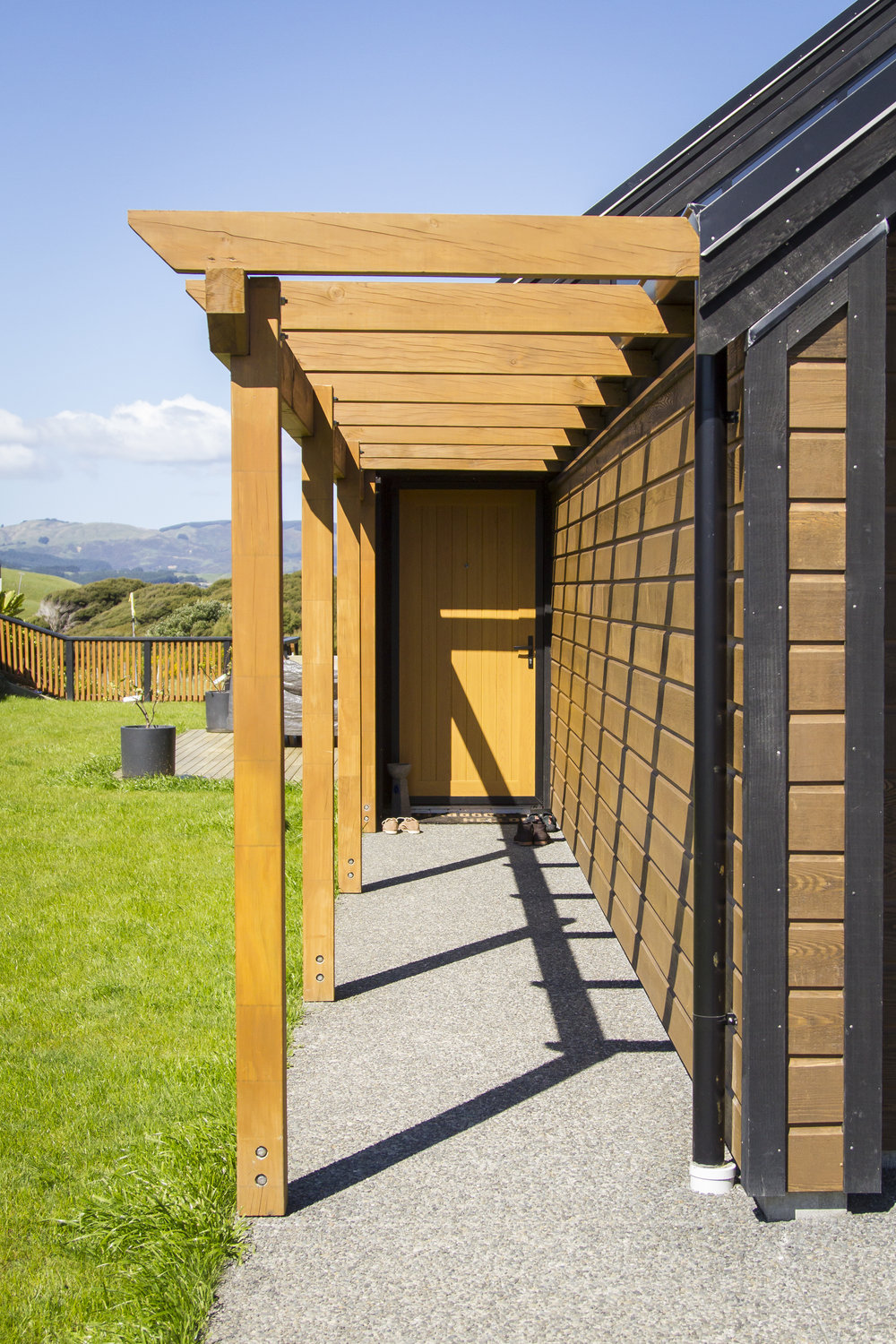 Entry  - Attached pergola to create walkway to set back entry