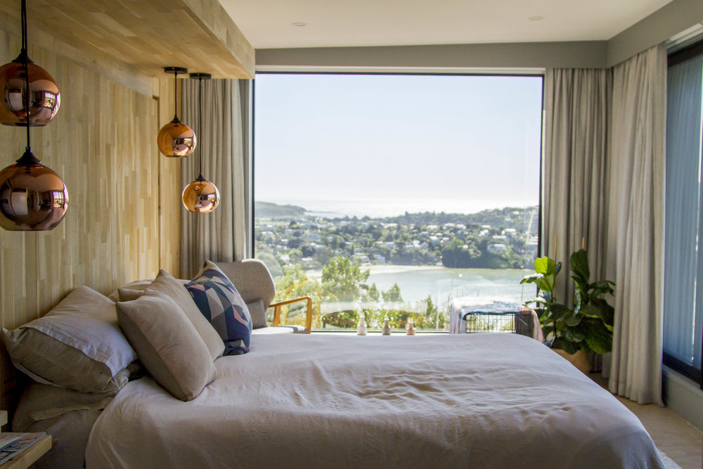 Master Bedroom Wing  - Large windows bring an abundance of light and make the most of the views over the inlet.