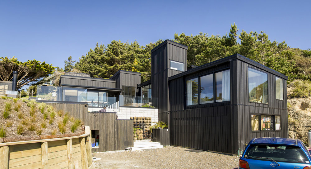 Front Elevation  - The multi-level and different shape structure with black stained timber creates a highly interesting elevation which completely modernised the old 70's design