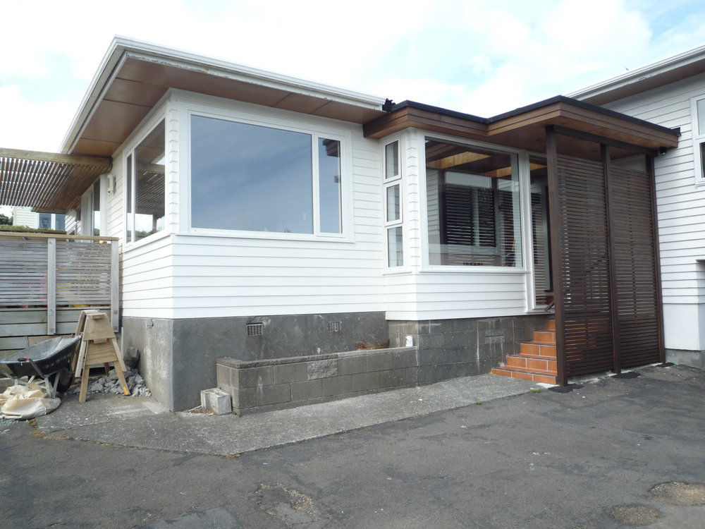 "Island Bay Entry Alterations  - This 1960's house entry porch required a maintenance upgrade, so a new entry area was designed by Studio8 to ""lift"" the arrival first impression from a back porch to a...  more"