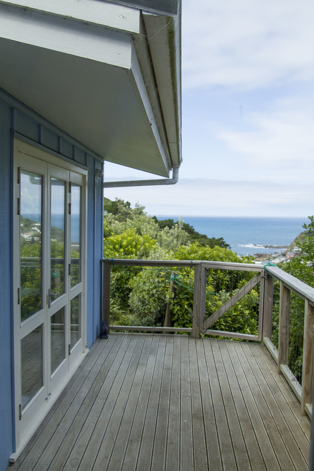 Houghton Bay Cottage  - A small seaside-like cottage with a magnificent big view of the Houghton Bay south coast. The bedroom area needed to be enlarged and include a seperate sitting/ relaxing room, and the two cottage buildings required easy covered access...  more