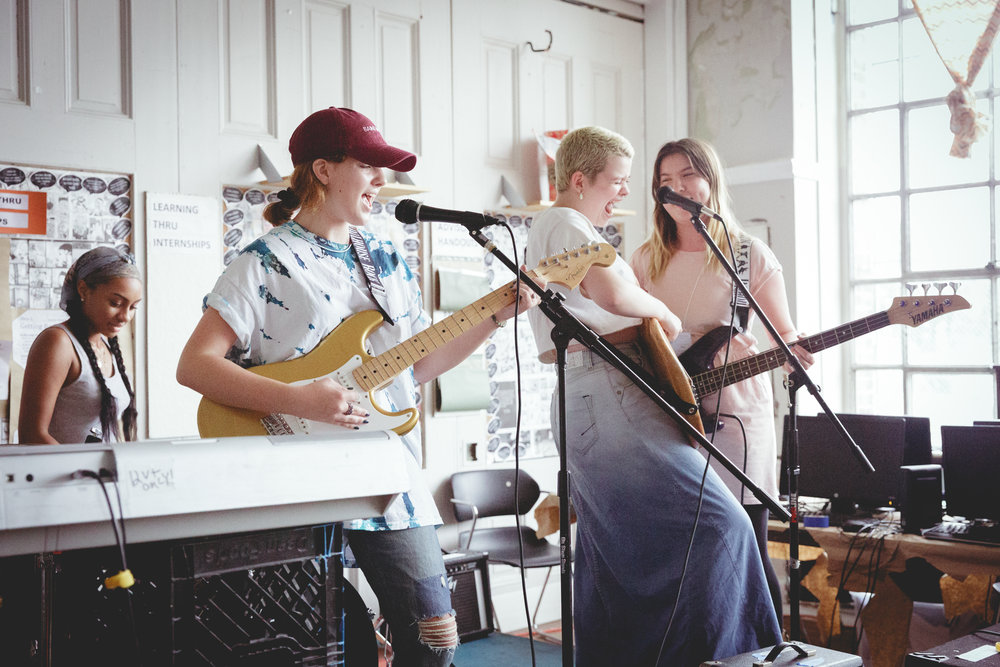 Our teen campers rocking out at 2018 Summer Rock Camp band practice.  Photo credit: Kristie Krause