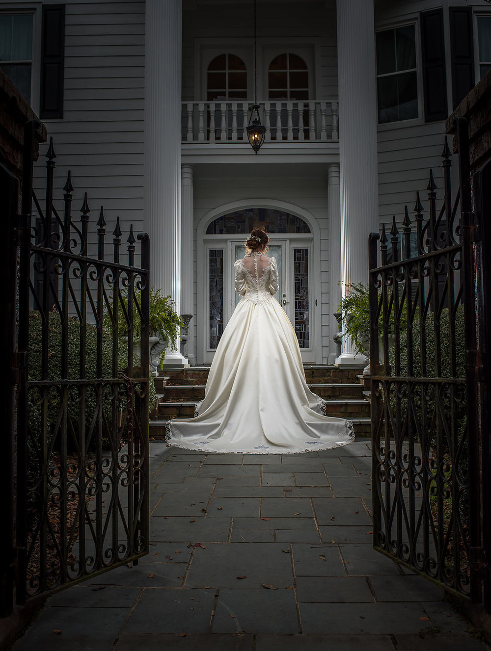 Bridal Portrait with Gates and Entrance at Matthews House in Cary NC.jpg