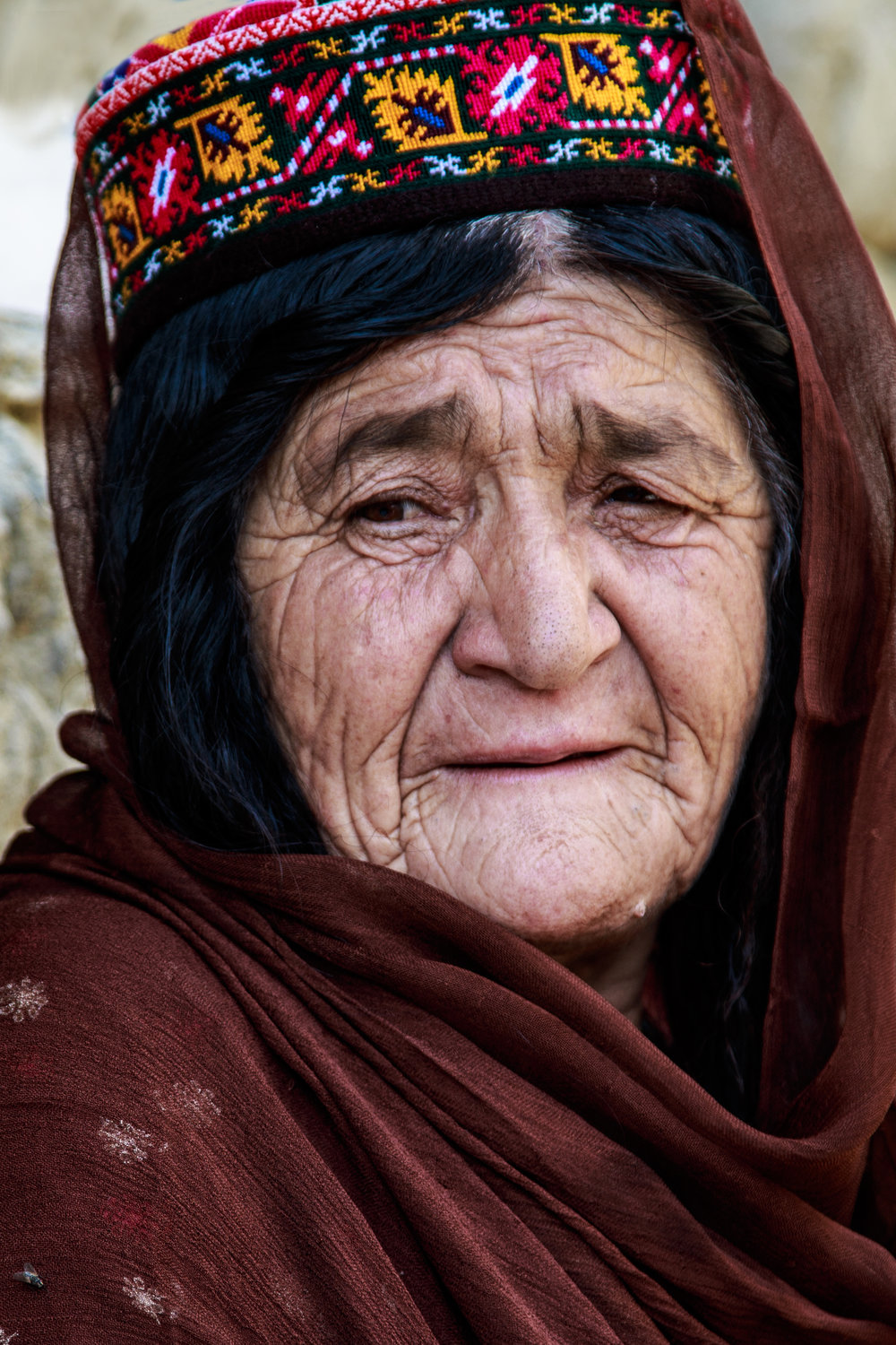 Hunzai Woman wearing a traditional embroidered hat