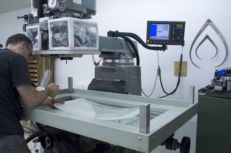 Securing the mounted glass on CNC mill