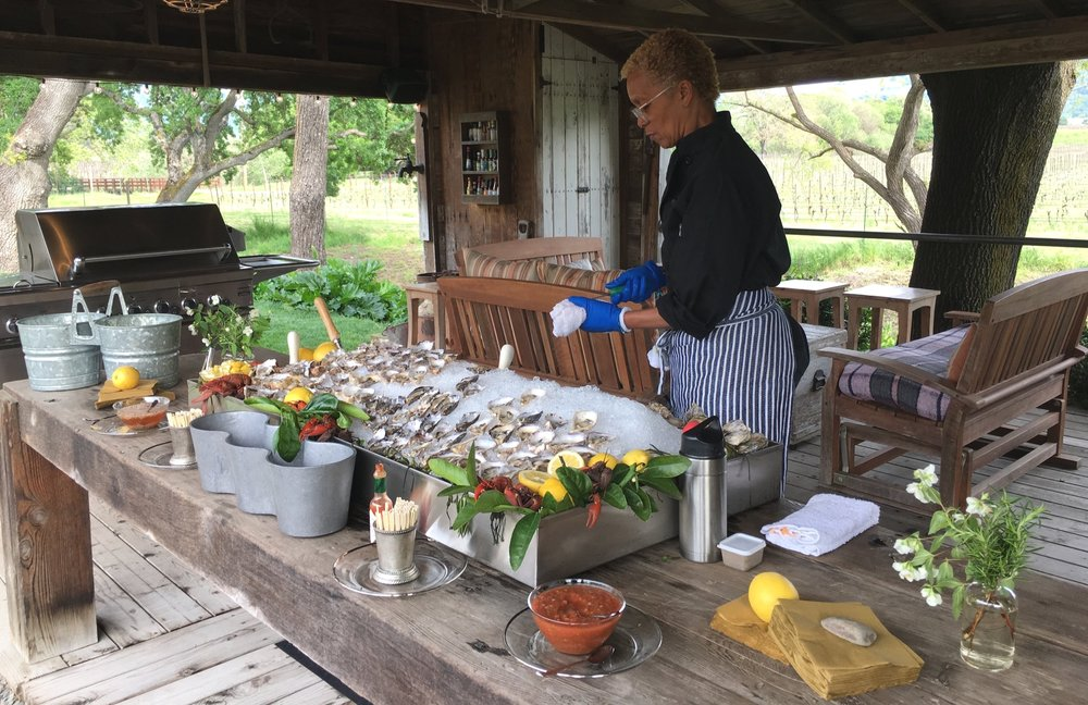 Renée puts the finishing touches on an oyster bar for a Wine Country garden party