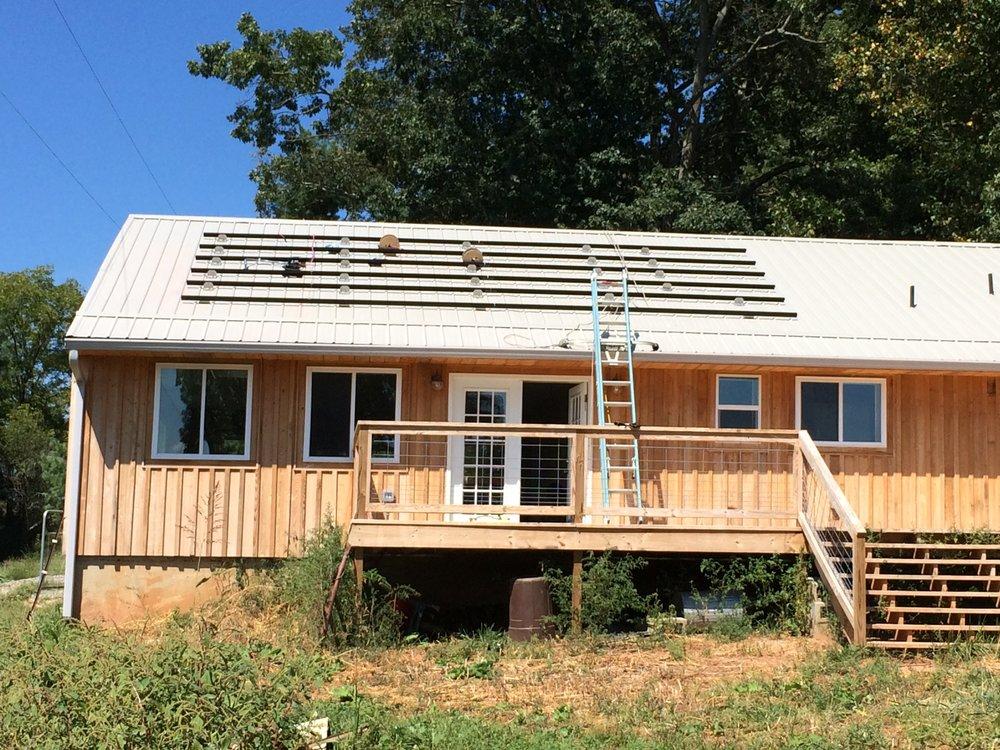 Sugar Hollow Solar installing the new solar PV system.