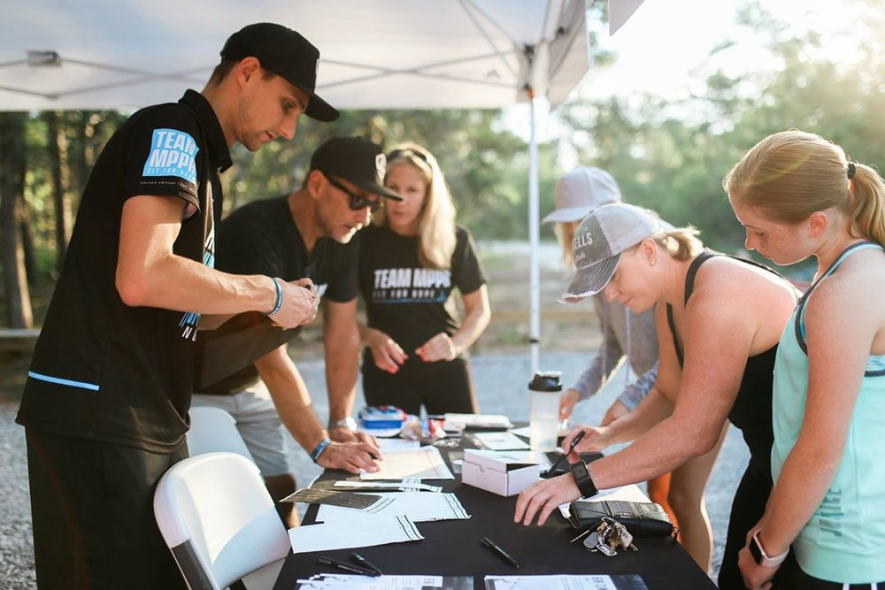 Volunteers helping register runners the morning of the run. All in all, 42 runners from across the panhandle braved the woods to take their shot at outrunning the bear for freedom!