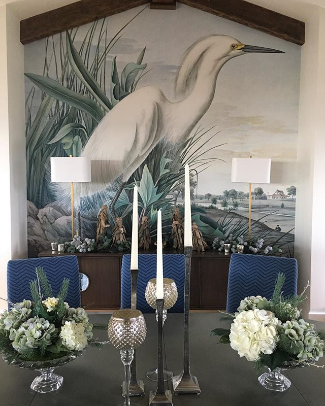 Getting our clients dining table ready for the holidays - cheers! 🥂  Floral arrangements: @ladytessflorals | Candlesticks: @chd_interiors | Mural: Custom/Hand painted | Lamps: @curreyco | Dining Chairs: @themtcompany with COM @thibaut_1886 fabric | @shealychr @theivy.co