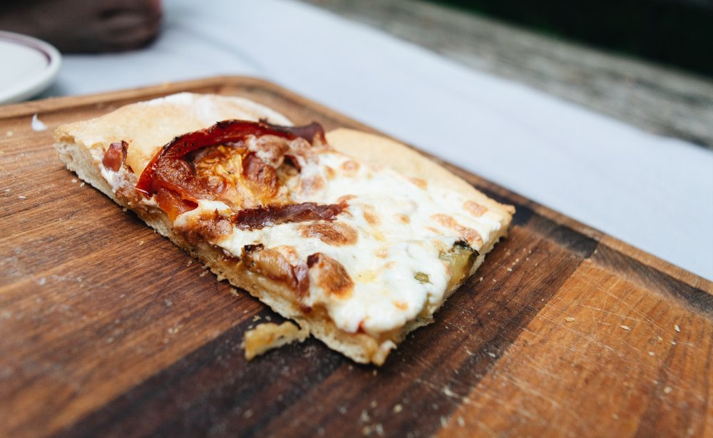Perhaps the best pizza of the summer. Tomato, prosciutto, sausage.