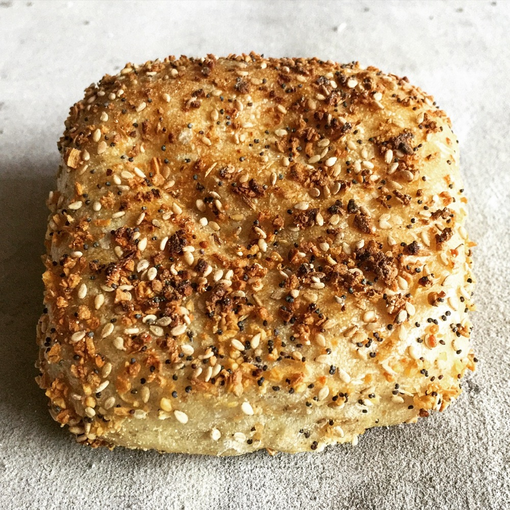 The Philly Muffin - Our flagship product, the Philly Muffin is its own product category. It has the nooks and crannies of its English counterpart, the seeded and sweet options of a bagel, and the sandwich making capabilities of a burger bun or ciabatta.Available in the following flavors: original, everything, cinnamon raisin, and house-milled heirloom wheat. Mini muffins are also available!Ingredients: White flour, wheat flour (milled daily), locally malted barley flour, water, salt, yeast, sourdough starter