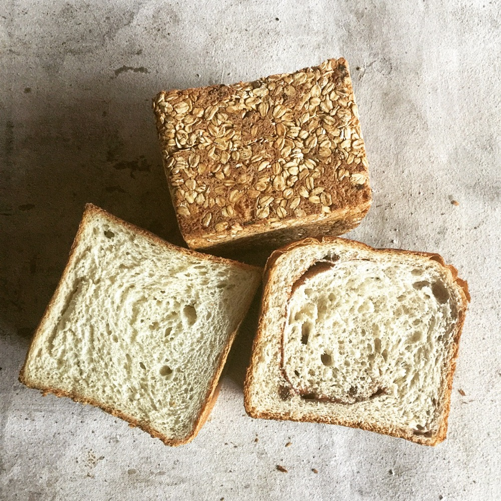 Pullman Loaf - A uniform, pan-baked shape and a denser, yet soft crumb makes our Pullman Loaf the utilitarian bread for your meal. Available in multigrain, rye, and potato. All perfect for sandwiches and great for everything else.Multigrain: Flour weight consists of 50% whole grains. Dough is mixed with a local grain and rye mash and slightly sweetened with molasses.Potato: Potato flour from Paradise Valley, PA. Poolish fermented.