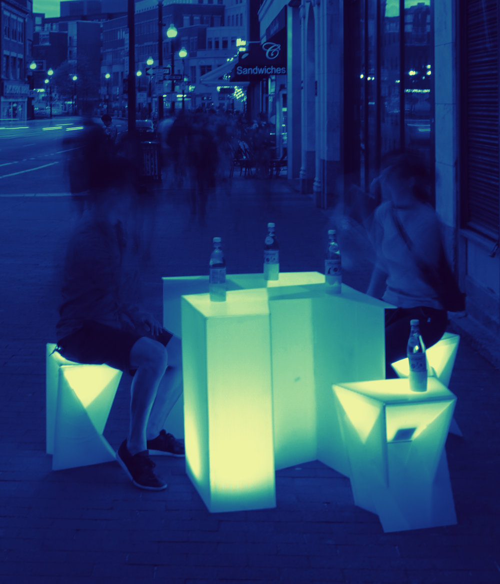 Future of Shopping - Street furniture / Flat Pack / Light InteractionThis project aimed to create a new street identity for those less traveled streets by utilizing vacant stores and the design of light interacted furniture and bottle lamp, to create pop-up event friendly and festival-feel environment.