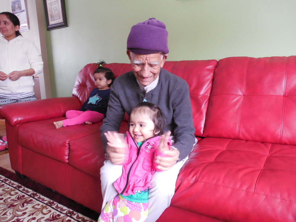 Here Ganga plays with his granddaughter in his home in Finneytown.