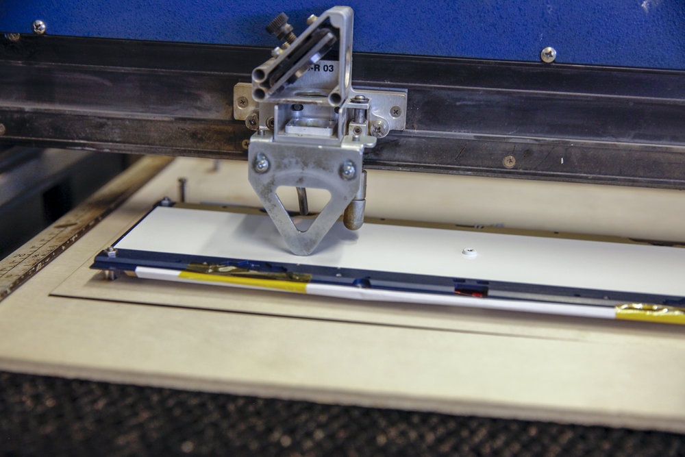 satellite panel in custom jig to level and stabilize the light weight aluminum in the laser cutting machine.