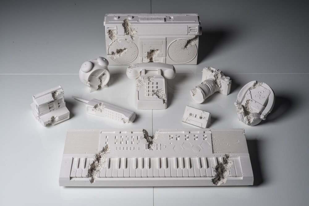 Daniel Arsham - Born in Ohio (1980), raised in Miami, Daniel Arsham attended New York City's Cooper Union. Where, in 2003, he received the Gelman Trust Fellowship Award. With his art, Arsham covers the links between the art, architecture, and performance. Perhaps the most prevalent subject within his work is architecture, through which he is able to mix the real with the surreal: landscapes where nature takes over structures, eroded walls and aimless stairs. This way, going against the typical expectations of space and form. However there is more to this paradoxical approach with architecture: Arsham's art also includes experimentation in structure, historical framework, and satirical acuteness.The works we present of Daniel Arsham are from a series entitled Future Relic. A project that sees nine classic items as protagonists; items that are no longer in production, like Polaroid camera, walkman, cassette tape, and more, reproduced in plaster and glass as if 'excavated' from the future. Hence the name, future - relic.Daniel Arsham is one of the founders of the influential Miami artist-run space 'The House'. As a result, the artist started to work with collaborations fairly early: in 2004 he got approached by renowned choreographer Merce Cunningham to create the stage design for his 'eyeSpace'. Arsham then toured with the dance company in Australia, France, and United States. One of Arsham's latest collaborations was with the globally known musician and producer Pharrell Williams, and involved the recreation of Pharrell's first keyboard in Volcanic Ash.Arsham is now represented by Galerie Emmanuel Perrotin in Paris, Hong Kong, New York, and Seoul, Moran Bondaroff in Los Angeles, Baro Galeria in Sao Paulo, Pippy Houldsworth in London, and Galerie Ron Mandos in Amsterdam.