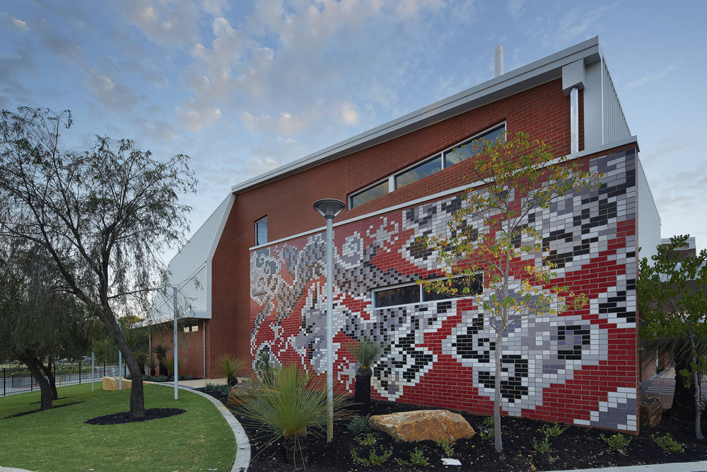 The unique Chinese and Aboriginal artwork integrated as part of the external fabric of the building was conceived and designed by Anne Neil and Noeleen Hamlett - Click Here for link to article.
