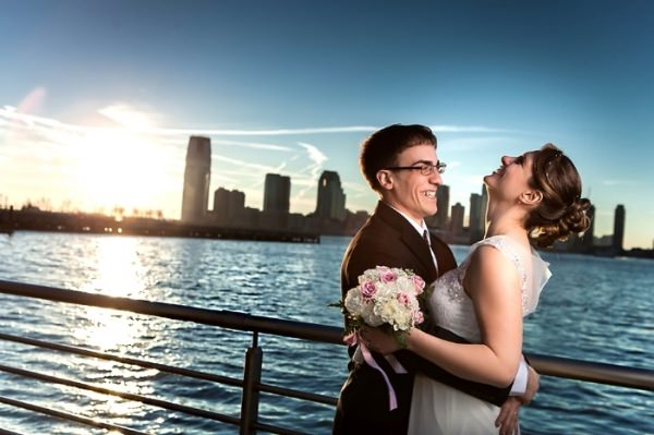 bride and groom by the water new york city