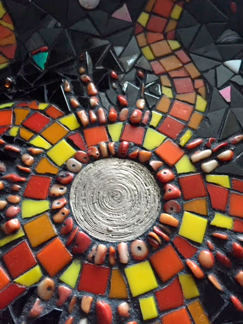 close-up-of-mosaic-sun-artwork-by-david-nicholls-portland-dorset.jpg